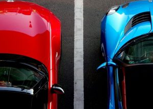 Image of a red and blue car parked