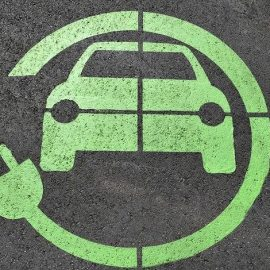 Decorative image showing a painted road sign for electric cars